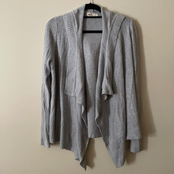 Light grey open front knit cardigan with hood.